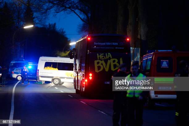 TOPSHOT The bus of Borussia Dortmund was damaged by explosion some 10km away from the stadium prior to the UEFA Champions League 1st leg quarterfinal...