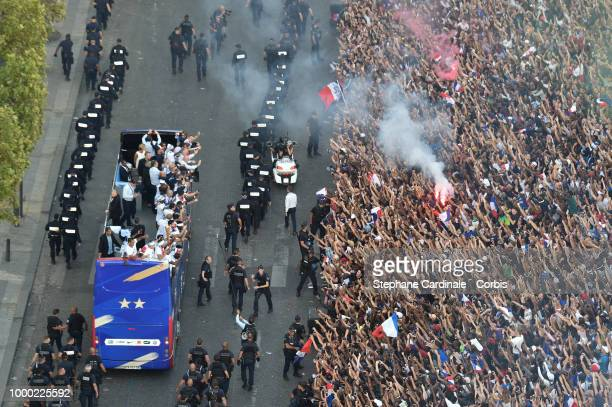 French fans attend the French football team parade on the Champs Elysees in a doubledecker bus the day after their victory in the 2018 World Cup...