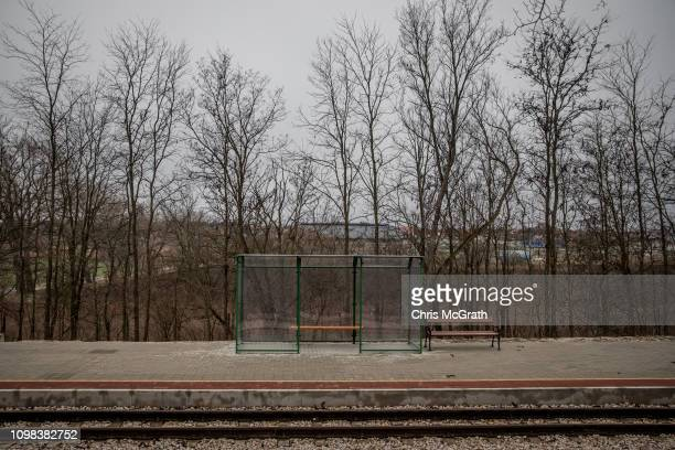 The bus stop at the Puskas Akademia train stop are seen on January 18, 2019 in Felcsut, Hungary. The vintage three car train with a wood-burning...