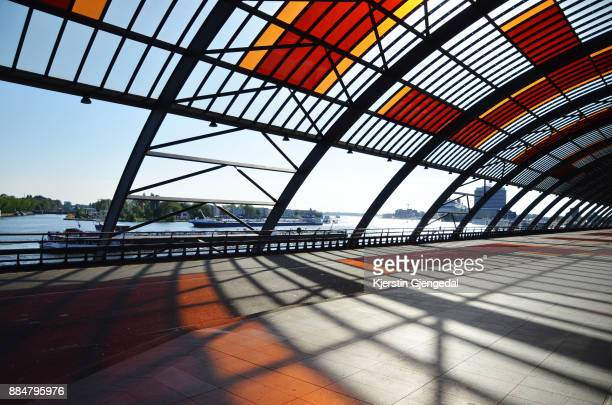 the bus terminal at amsterdam central station - station stock pictures, royalty-free photos & images