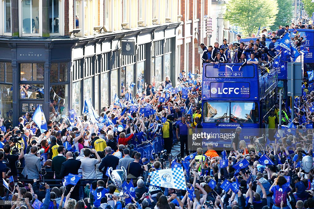 The Buses carrying the Leicester squad and trophy make their way through the the streets during the Leicester City Barclays Premier League winners bus parade on May 16, 2016 in Leicester, England.
