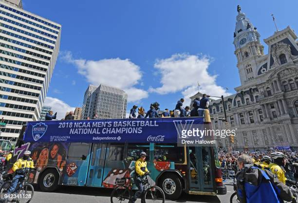 The buses carrying Villanova Wildcats players pull around City Hall during the Championship Parade on April 5 2018 in Philadelphia Pennsylvania