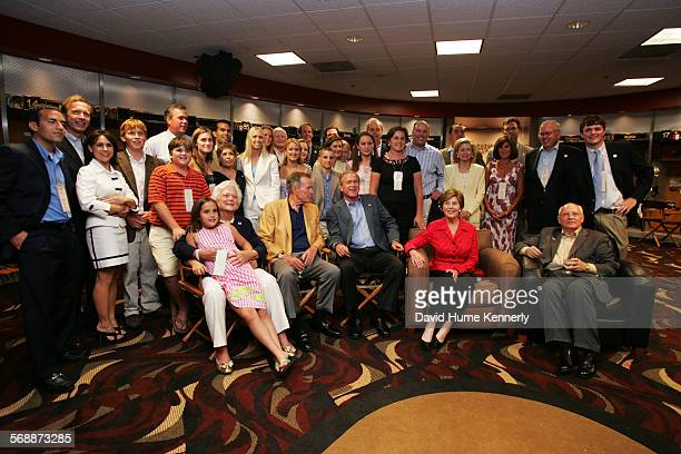 The Bush clan assembles in the Houston Astro's locker room to honor former President George H W Bush's 80th birthday on June 12 2004 in Houston TX at...