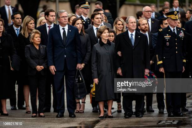 The Bush family watches the casket of former President George H.W. Bush as it is loaded into a hearse on December 6, 2018 in College Station, Texas....
