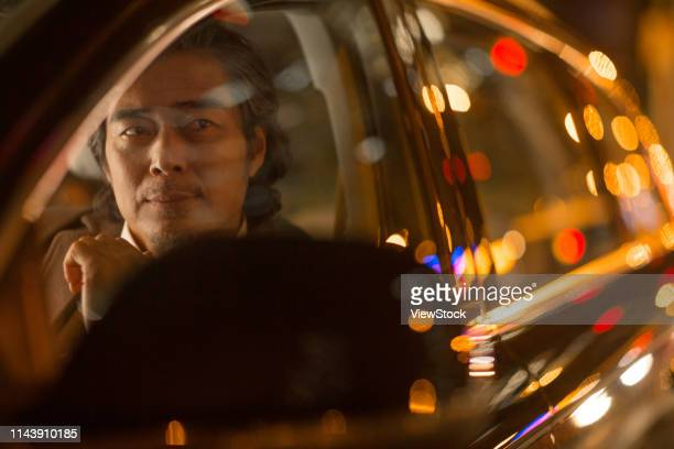 the business man driving a car - one man only stock pictures, royalty-free photos & images