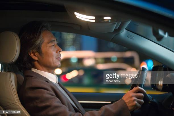 the business man driving a car - one mid adult man only stock pictures, royalty-free photos & images