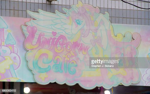 The business sign at the Unicorn Cafe a unicorn and rainbow themed cafe in Bangkok Thailand