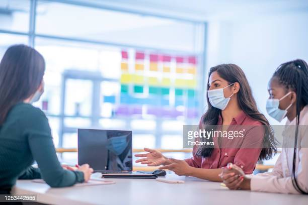 the business women wearing masks - illness prevention stock pictures, royalty-free photos & images
