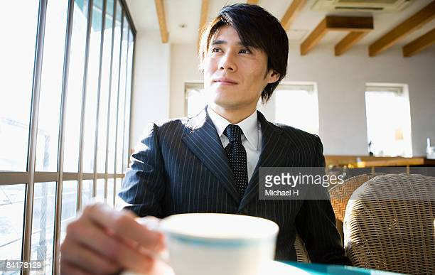 the businessman who drinks coffee - one mid adult man only stock pictures, royalty-free photos & images