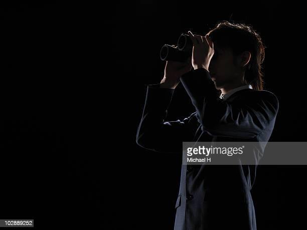 The businessman who looks in binoculars