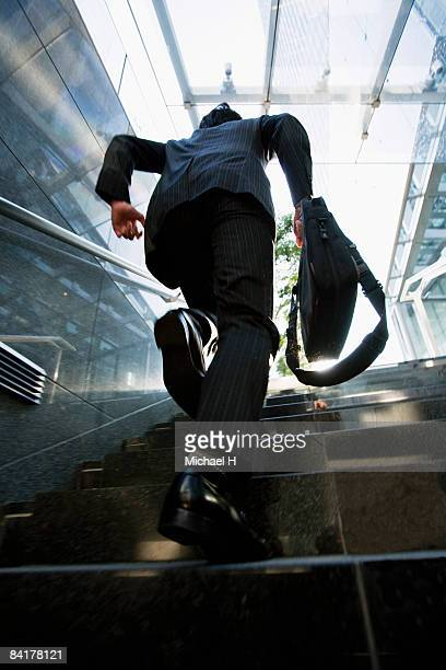 The businessman who runs up stairs