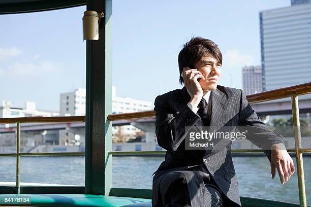 The businessman who talks on the telephone by ship