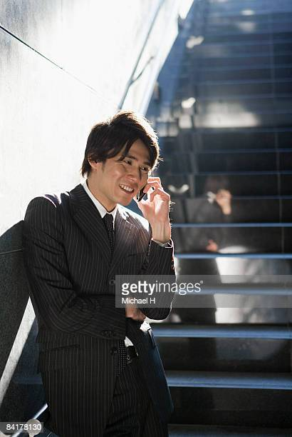 The businessman who talks with a mobile telephone