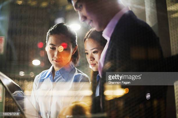 The businessmen through a window at night