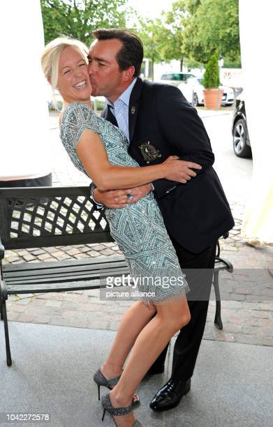 The businesswoman Andrea Muehlbauer and her partner Falk Raudies at the gala that is being held as part of the 29th Kaiser Cup golf tournament The...