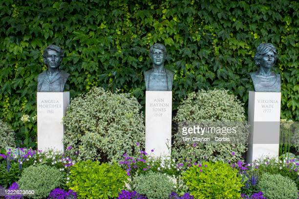 The busts of Angela Mortimer Ann Haydon Jones and Virginia Wade outside the main entrance to AELTC during the Wimbledon Lawn Tennis Championships at...