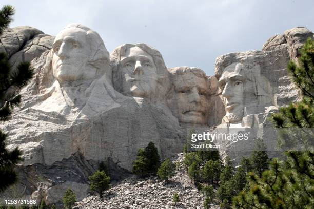 The busts of US presidents George Washington Thomas Jefferson Theodore Roosevelt and Abraham Lincoln tower over the Black Hills at Mount Rushmore...