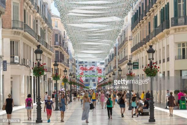 the busy calle marques de larios in central malaga. - málaga málaga province stock pictures, royalty-free photos & images