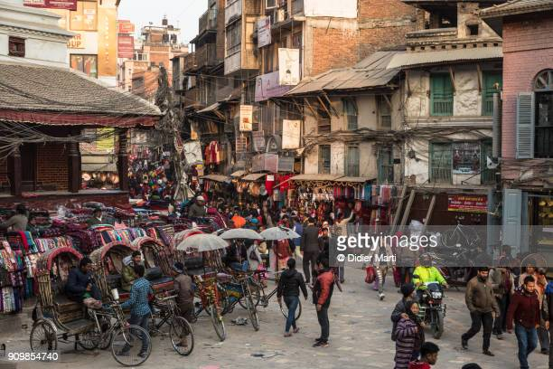 the busy indra chowk intersection in the heart of kathmandu old town in nepal - nepal stock pictures, royalty-free photos & images