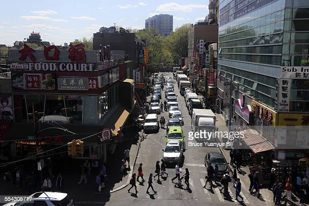 the busy street view of flushing chinatown - flushing queens stock pictures, royalty-free photos & images