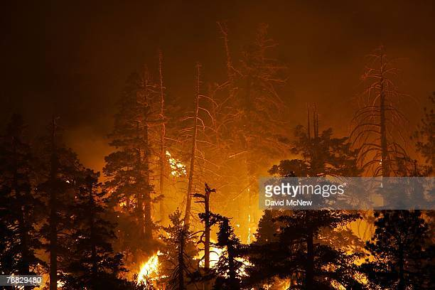 The Butler 2 Fire burns through the early morning hours on September 18, 2007 near Fawnskin, California. Earlier today, a single-engine air tanker...