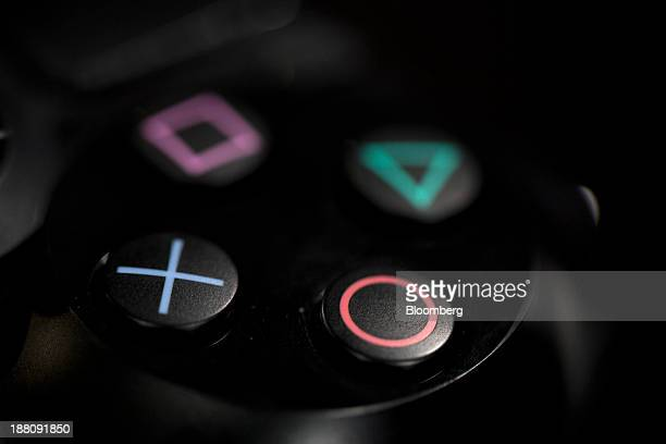 The buttons of a Sony PlayStation 4 games controller manufactured by Sony Corp are seen in this arranged photograph taken in London UK on Friday Nov...