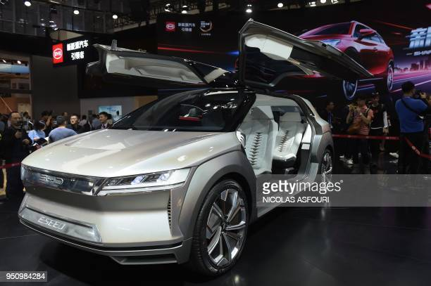 The BYD ESEED concept car is viewed by visitors during the Beijing Auto Show in Beijing on April 25 2018 Industry behemoths like Volkswagen Daimler...