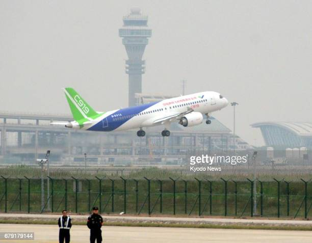 The C919 China's first domestically built jetliner takes off from the Shanghai Pudong International Airport on May 5 for a maiden flight ==Kyodo