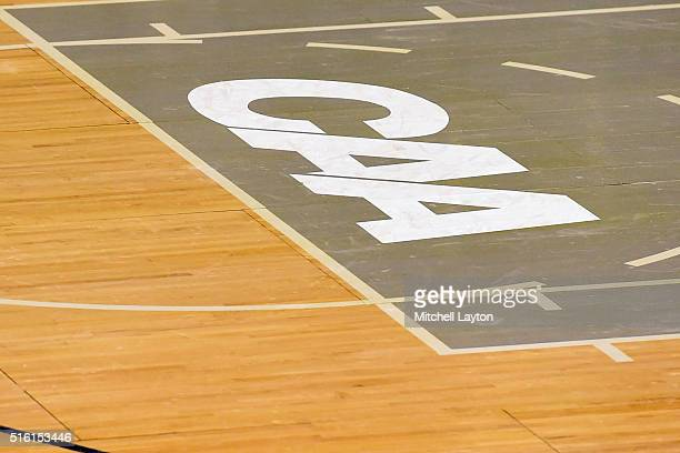 The CAA logo on the floor during the Colonial Athletic Conference Championship college basketball game between the North CarolinaWilmington Seahawks...