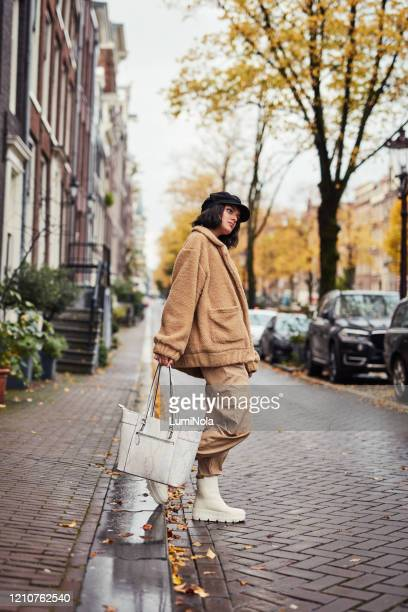the cab seems a little bit late… - fashions hats and handbags stock pictures, royalty-free photos & images