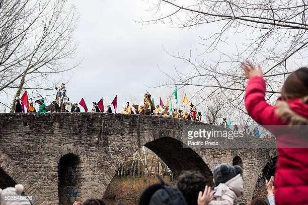 The Cabalgata Los Reyes Magos cross the Magdalena bridge over Arga River the day before Epiphany in Pamplona