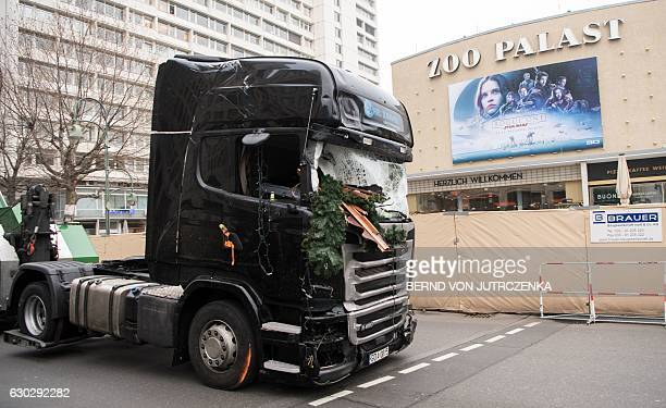 The cabin of a truck is pulled off the Christmas market past the Zoopalast cinema near the KaiserWilhelmGedaechtniskirche the day after a terror...
