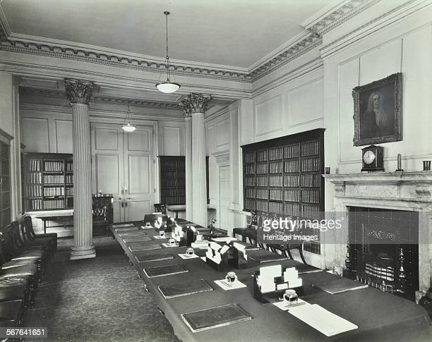 The Cabinet Room at Number 10 Downing Street London 1927 Interior with table ready for a meeting Classical columns bookshelves and fireplace at the...