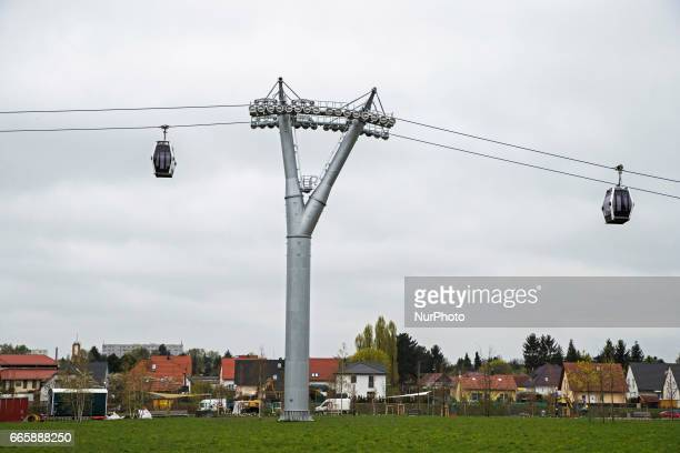 The cable car and housing are pictured during a press preview of the IGA 2017 in Berlin Germany on April 7 2017 Last arrangements are being done for...