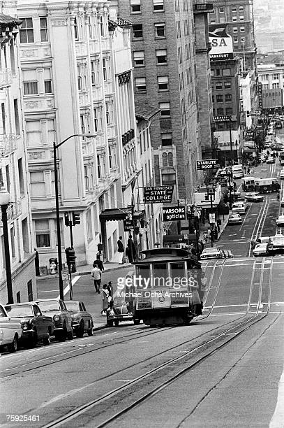 The cable cars are a noted feature of the city even if they don't climb halfway to the stars in early summer 1967 in San Francisco California