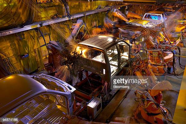 The cabs of General Motors pickup trucks move through a completely automated robotic welding operation on the assembly line at the Oshawa Truck...
