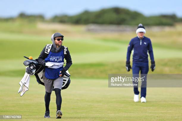 The caddie of Eddie Pepperell of England walks on the 12th fairway during Day Three of the Scottish Championship presented by AXA at Fairmont St...