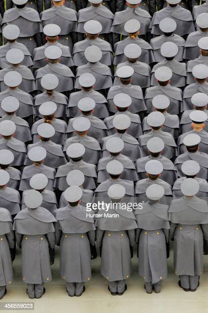 The Cadets of West Point stand at attention during the ceremonial march on to the field before a game between the Army Black Nights and the Navy...