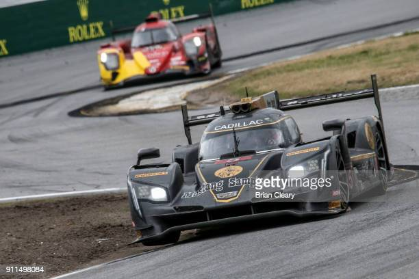 The Cadillac DPi of Christian Fittipaldi of Brazil Joao Barbosa of Portugal and Felipe Albuquerque of Portugal races on the track during the Rolex 24...