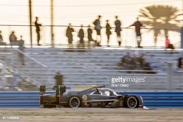The Cadillac DPi of Christian Fittipaldi of Brazil Joao Barbosa of Poertugal and Felipe Albuquerque of Portugal races on the track during the Rolex...
