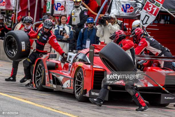 The Cadillac DPi of Dane Cameron and Eric Curran makes a pit stop during the Mobil 1 Sportscar Grand Prix IMSA WeatherTech Series race at Canadian...
