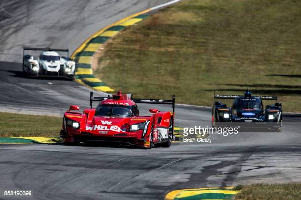 The Cadillac DPi of Dane Cameron, Eric Curran, and Michael Conway, of Great Britain, races on the track during practice for the Motul Petit Le Mans...