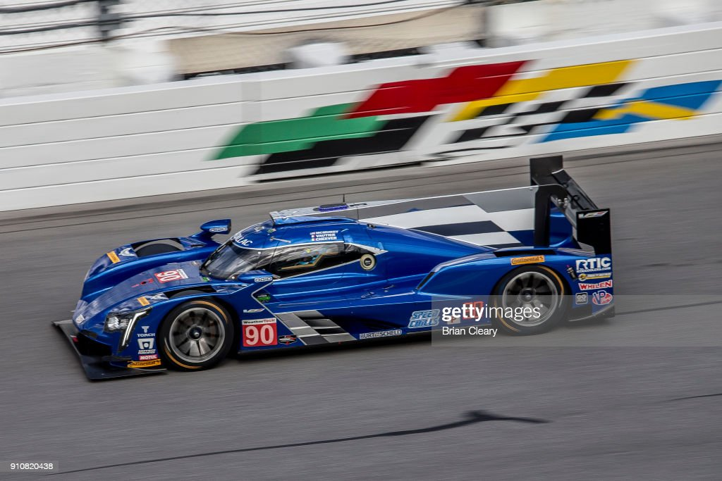 The #90 Cadillac DPi of Eddie Cheever Jr., Tristan Vautier, of France, and Matt McMurry races on the track during parctice before the Rolex 24 at Daytona at Daytona International Speedway on January 26, 2018 in Daytona Beach, Florida.