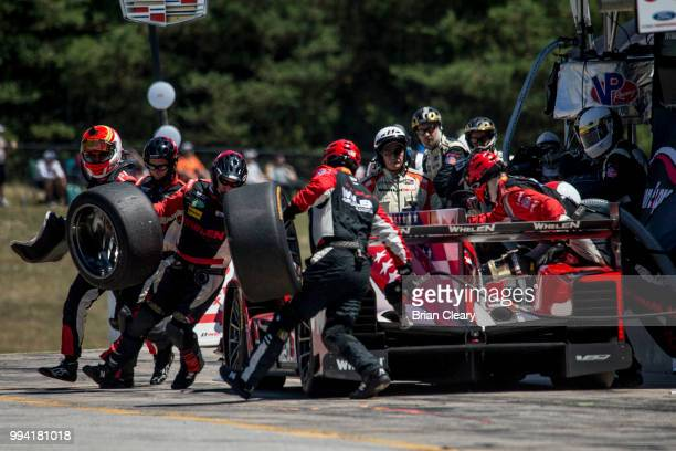 The Cadillac DPi of Eric Curran and Felipe Nasr of Portugal makes a pit stop during the IMSA WeatherTech race at Canadian Tire Motorsport Park on...
