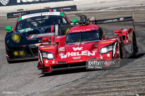 The Cadillac DPi of Eric Curran and Felipe Nasr of Portugal races on the track during practice for the IMSA Continental Road Race Showcase at Road...