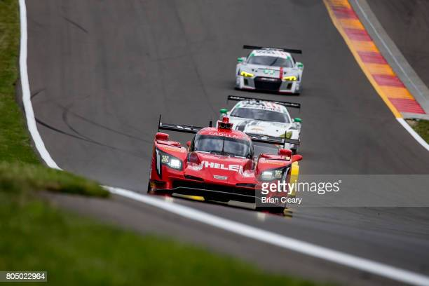 The Cadillac DPi of Filipe Albuquerque of Portugal Eric Curran and Dane Cameron races on the track during practice for the Sahlen's Six Hours of the...