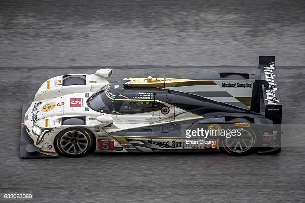The Cadillac DPi of Joao Barbosa Christian Fittipaldi and Filipe Albuquerque races on thre track during the 24 Hours of Daytona at Daytona...
