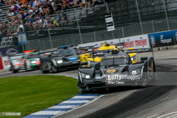 The Cadillac DPi of Joao Barbosa of Portugal and Felipe Albuquerque of Portugal races on the track during the IMSA WeatherTech race at the Chevrolet...