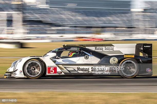 The Cadillac DPi of Joao Barbosa of Portugal Christian Fittipaldi of Brazil and Filipe Albuquerque of Portugal drives on the track during IMSA Roar...