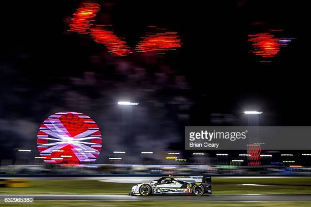 The Cadillac DPi of Joao Barbosa of Portugal Christian Fittipaldi of Brazil and Filipe Albuquerque of Portugal races on the track at night during the...
